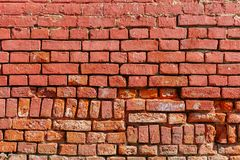 Old weathered wall of red brick. Abstract background royalty free stock photo