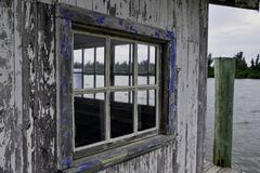 Old weathered window on a shack on a florida waterway royalty free stock image