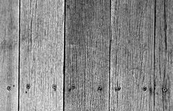 Old weathered wood plank. Close-up image of old weathered wood planks flooring in black and white, arranged and put in place and secured in position with many Royalty Free Stock Photography