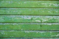 Old weathered wood planks painted in green. Stock Photos