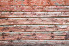 Old weathered wood planks painted in red Royalty Free Stock Photo
