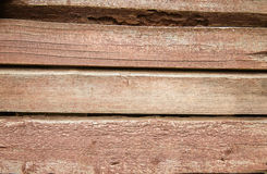 Old weathered wood planks painted in red Stock Photos
