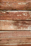 Old weathered wood planks painted in red Stock Photo