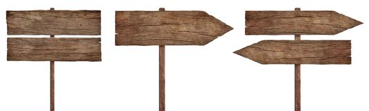 Old weathered wood signs, arrows and signposts. Three empty weathered roadsigns made of dark old wood. Pointing in different directions. Isolated on white stock photos