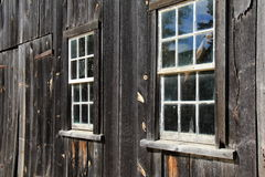 Old,weathered wood wall with glass paned windows Royalty Free Stock Photos