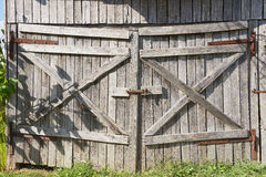 Old weathered wooden barn gate. Royalty Free Stock Photos