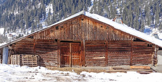 Old weathered wooden barn Stock Photo