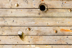 Old weathered wooden boards with holes on the surface. Texture of natural wood. Abstract background Stock Image
