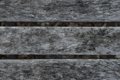 Old weathered wooden chair planking texture. Wood slats. Royalty Free Stock Image