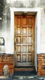 Old weathered wooden door on a brick wall royalty free stock images