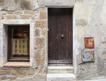 Old weathered wooden door and window of rustic village house, Tu royalty free stock photos