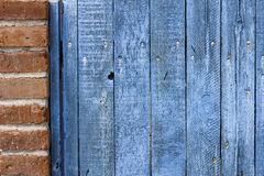 Old weathered wooden fence stained blue Royalty Free Stock Photo