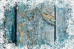 Old weathered wooden plank painted in blue color, wooden texture wall with snow effect christmas background stock photography