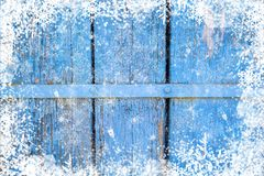Old weathered wooden plank painted in blue color, wooden texture wall with snow effect christmas background royalty free stock photo
