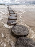 Old and weathered wooden wave breakers. Ustka, Baltic Sea, Poland Royalty Free Stock Photography