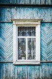 The old weathered wooden window with hinges and carved shutters. Retro stock photography