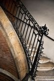 Wrought iron handrail. Old and weathered wrought iron handrail in a French mansion royalty free stock image