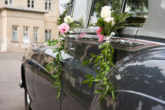 Old wedding car and flowers Royalty Free Stock Photography