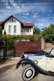 Old wedding car in front of house.  Royalty Free Stock Photo