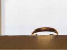 Old wedding ring. Ancient wedding ring, in gold, with reflections and shadows Stock Images