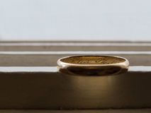 Old wedding ring. Ancient wedding ring, in gold, with reflections and shadows, and inscriptions Stock Images