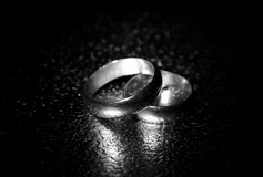 Old wedding rings, water effect. A shot of two gold wedding rings, water effect in black and white Royalty Free Stock Images
