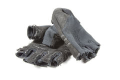 Old weight gloves for lifting dumbbells with selective focus on Stock Photography