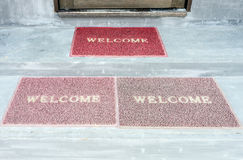 Old welcome doormat Stock Photos
