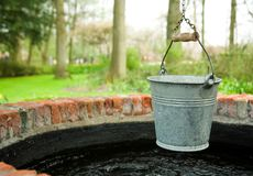 Old well. Bucket and an old well Royalty Free Stock Image