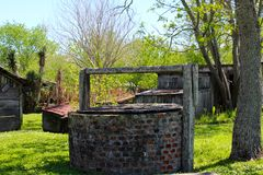 Old Well. An old brick well watering hole on the green grass near a Louisiana plantation Royalty Free Stock Photo