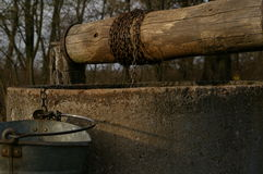 Old well, bucket and string. Royalty Free Stock Image