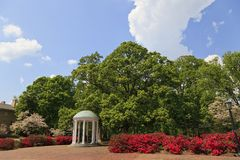 The Old Well at Chapel Hill. The Old Well at UNC Chapel Hill during the springtime with azaleas blooming royalty free stock images