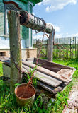 Old well and cottage Royalty Free Stock Image
