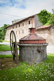 Old well covered with hand pump. Royalty Free Stock Photo