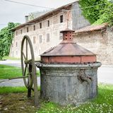 Old well covered with hand pump. Royalty Free Stock Photos