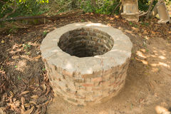 An old well at cultural village Stock Images