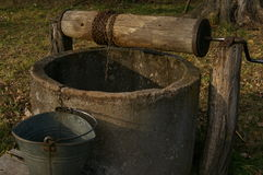 Old well, drum, bucket and string. Royalty Free Stock Image