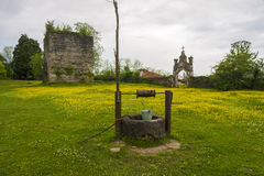 Old well with iron bucket Royalty Free Stock Photography