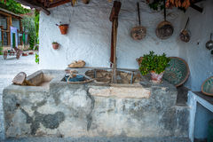 Old well located in a yard of a typical house in Granada, Spain Stock Photography