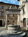 Old well in Piazza Grande - Montepulciano Royalty Free Stock Image