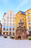 Old well on Stortorget square, a small public square in Gamla Stan royalty free stock images