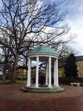 Old Well in UNC campus winter Christmas trees Chapel Royalty Free Stock Photos