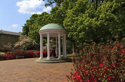 The Old Well at Chapel Hill. The Old Well at UNC Chapel Hill during the springtime with azaleas blooming stock photo