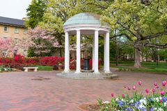 Old Well at University of North Carolina. Flowers Bloom in Spring at the Old Well Rotunda at University of North Carolina in Chapel Hill stock image