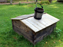 The old well. Well with a wooden bucket royalty free stock image