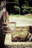 Old well and wooden bucket Stock Photo