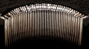 Old well worn antique typewriter key striker set stock image