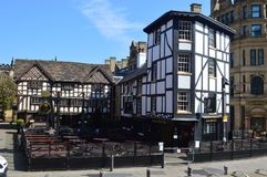 The Old Wellington Inn Manchester. The Old Wellington Inn is a half-timbered pub in Manchester city centre, England. It is part of Shambles Square, which was stock photography