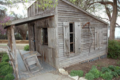 The Old West. Old cottage replica of what a real cottage would have looked like in the country in the United States Western area. 1800's Royalty Free Stock Photography