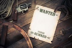 Old west background with dramatic light and wanted poster Royalty Free Stock Photography